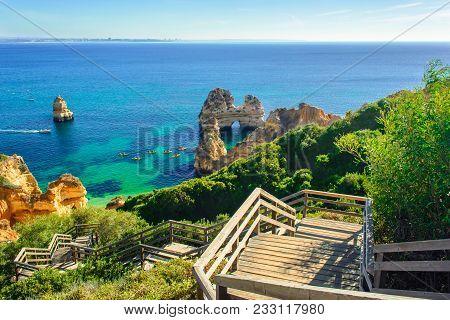 Wooden Footbridge To Secret Beach Near Lagos On Ponta Da Piedade. Algarve Region, Portugal