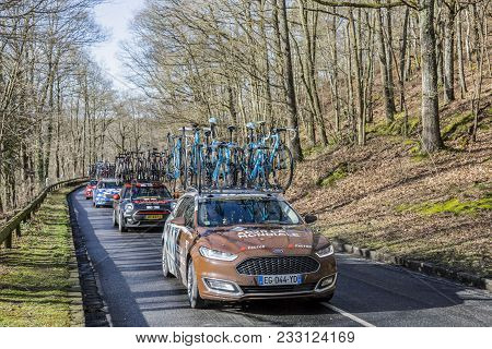 Cote De Senlisse,, France - March 5, 2017: The Technical Car Of Ag2r La Mondiale Team Driving In The
