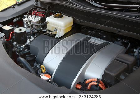 Engine bay of a car, hybrid system under the hood