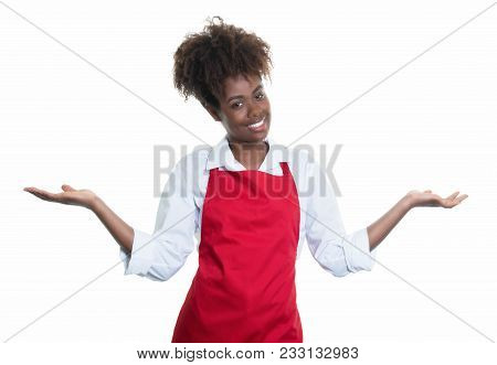 Laughing African American Waitress With Red Apron Inviting Guests On An Isolated White Background Fo
