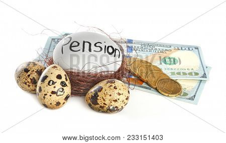 Money and egg with word PENSION in nest on white background