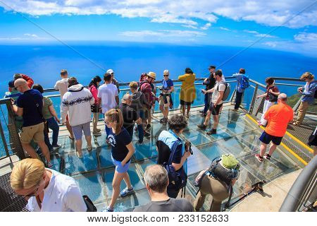 Madeira, Portugal - March 23, 2018: Tourists Standing On The Glass Floor Of The Sea On The Platform