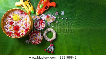Thai Traditional Jasmine Garland And Colorful Flower In Water Bowls Decorating And Scented Water, Pe