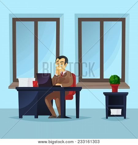 Businessman Working On Laptop At Office Desk. Manager Wearing Brown Business Suit And Tie In Office