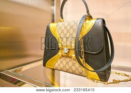 MILAN, ITALY - CIRCA NOVEMBER, 2017: close up shot of Gucci bag on display at Rinascente. Rinascente is a collection of high-end stores.