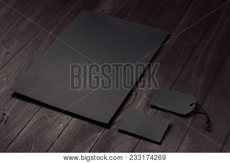 Blank Black Letterhead, Label, Business Card On Dark Wood Board. Mock Up For Branding, Business Pres