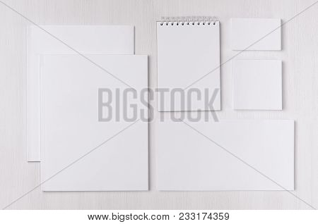 Branding Business Mock Up Of White Blank Stationery Set On Light Soft White Wooden Background. Templ