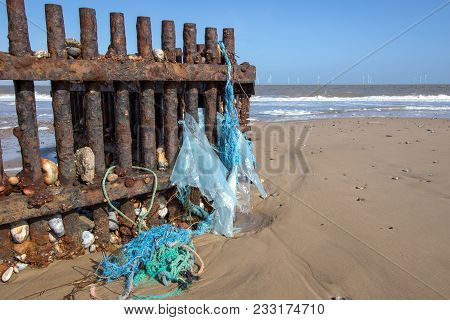 Plastic Pollution. Environmental Beach Waste Washed Up From The Sea. Typical Ocean Rubbish Found On