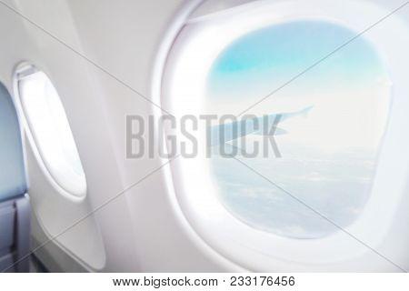 Airplane Window View Inside An Aircraft. Window Plane. Vacation Destinations Concept. Light Blue Sea