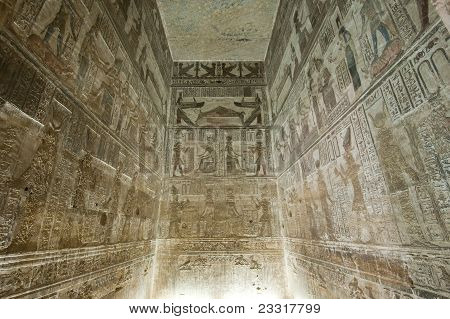 Hieroglyphic carvings and paintings on the interior walls of an ancient egyptian temple poster