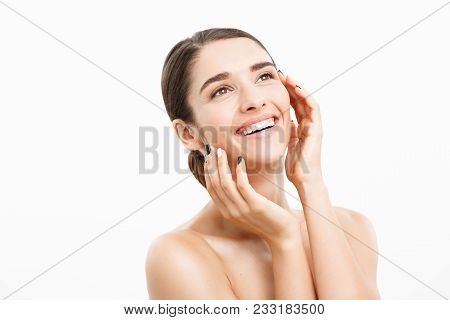 Beauty And Skin Care Concept - Close Up Beautiful Young Woman Touching Her Skin On White Background