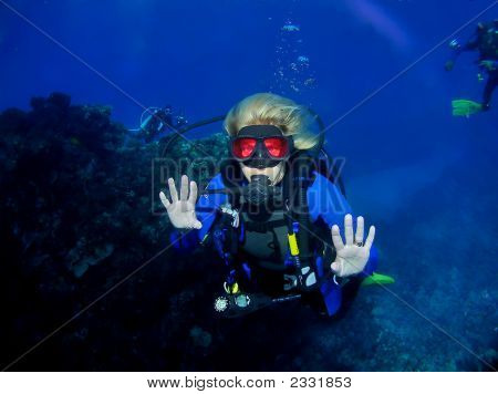 Woman Scuba Diving In A Red Mask