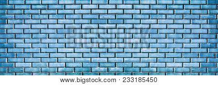 Blue Brick Wall Texture. Grunge Indigo Brickwork Background