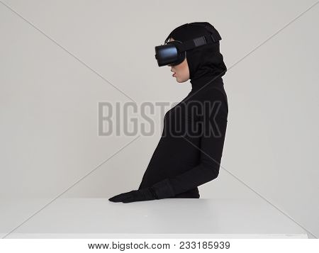 Woman Is Posing In Vr Headset. An Excited Woman Experiencing The Virtual Reality Helmet. Hi-tech Gad