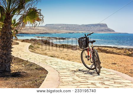 Parked Mountain Bike On Bicycle Route Against Background Of The Mediterranean Sea Cycling Along Sea