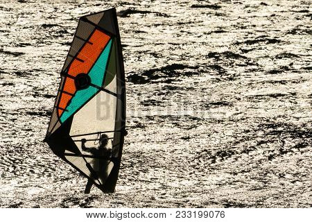 Windsurfer In The Evening Sun