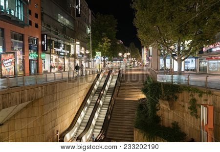 Stuttgart, Germany - September 12 2017;  Night Street And Building Scene, Entrance And Escalator Dow