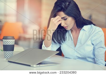 Young Busy Beautiful Latin Business Woman Suffering Stress Working At Office Computer.