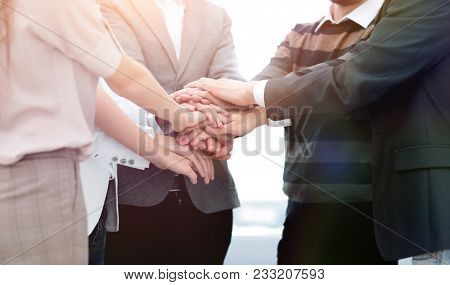 business colleagues with their hands stacked together