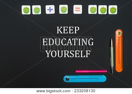 Black Art Table With Stationery Supplies With Words Keep Education Yourself. Back To School Concept,