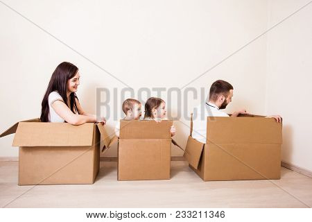 Happy Family With Two Adorable Kids Have A Moving House Day