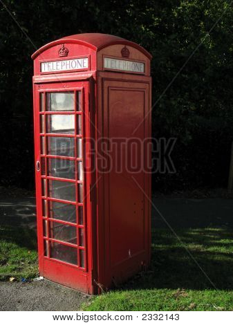Traditional British Telephone Box In Urban Setting