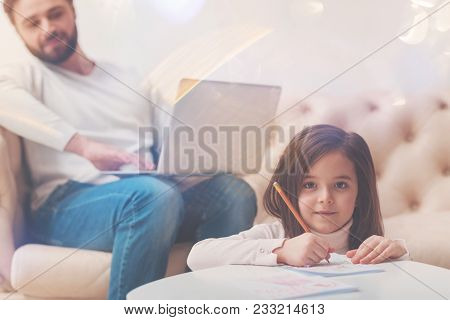 Cute Artist. Attentive Committed Loving Father Trying Finishing His Work And Paying Attention To His