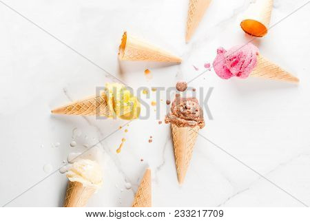 Homemade Chocolate, Vanilla, Berry Ice Cream In Ice Cream Cones, White Marble Background Copy Space