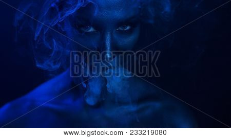 Halloween Vape Party, Nightlife. Beautiful Sexy Young Woman With Glamorous Mystical Makeup Vaping In