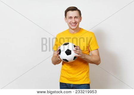 Inspired Young Cheerful European Man, Fan Or Player In Yellow Uniform Hold Soccer Ball, Cheer Favori