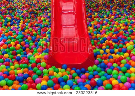 Lots Of Colored Balls In A Playground Ball Pool.ball With Colorful Plastic Balls In Children Enterta