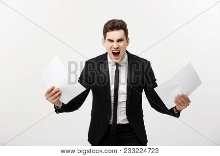 Business, People, Paperwork And Deadline Concept - Stressed Handsome Businessman With Papers And Cha