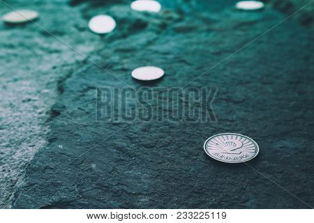 Macedonia Currency Two Denar On The Stone Background. Photo Depicts Macedonian Valuta Shiny Denari M