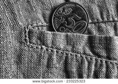 Euro Coin With A Denomination Of Fifty Euro Cents In The Pocket Of Worn Linen Pants, Monochrome Shot