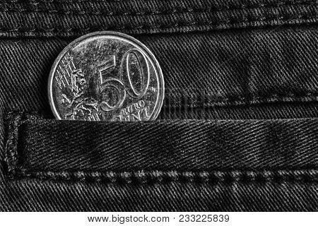 Euro Coin With A Denomination Of Fifty Euro Cents In The Pocket Of Dark Denim Jeans, Monochrome Shot