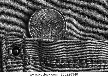 Euro Coin With A Denomination Of Fifty Euro Cents In The Pocket Of Denim Jeans, Monochrome Shot.