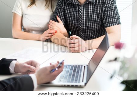 Couple having meeting with banker in bank or salesman in office. Financial consulting and guidance. People asking professional help for future investments or having discussion with real estate agent. poster