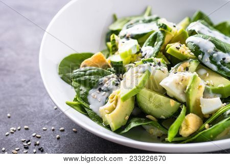 Green Salad. Fresh Salad From Spinach, Avocado, Eggs And Cucumber With Yogurt Dressing. Close Up.