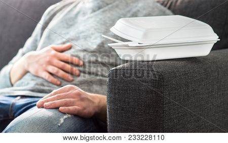 Man Having Stomach Pain Or Digestion Problem. Couch Potato, Lazy Or Unemployed Person Taking Nap. Fe