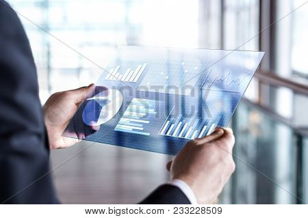 Transparent Futuristic Tablet. Business Man Using Virtual Touch Screen. Modern Mobile Technology In