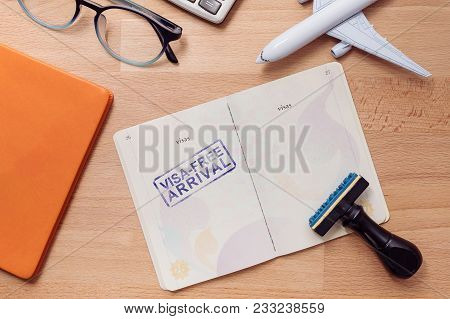Visa Free Arrival Stamp On Foreign Passport With Airplane Model. Oversea Travel In Visa Free Arrival