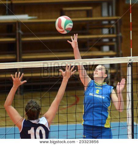 KAPOSVAR, HUNGARY - APRIL 24: Zsanett Pinter (R) in action at the Hungarian NB I. League woman volleyball game Kaposvar (blue) vs Ujbuda (black), April 24, 2011 in Kaposvar, Hungary.