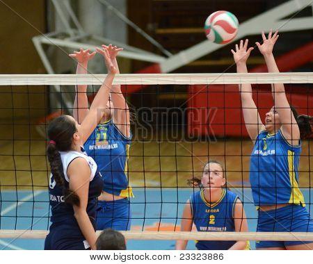 KAPOSVAR, HUNGARY - APRIL 24: Barbara Balajcza (R) in action at the Hungarian NB I. League woman volleyball game Kaposvar (blue) vs Ujbuda (black), April 24, 2011 in Kaposvar, Hungary.