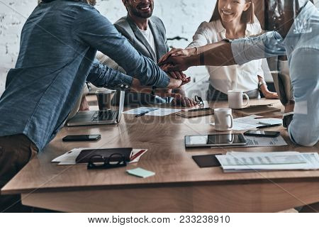 Successful Team. Close Up Of A Diverse Group Of Business Colleagues Holding Hands On Top Of One Anot