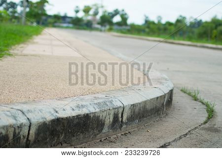 Cement Corner Of The Street On Green