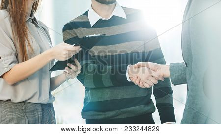 Senior Manager Shakes Hands With The Employee In A Workplace In A Modern Office