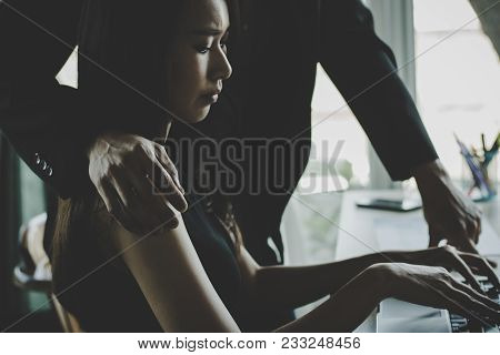 Sexual Harassment Concept, Businessman Making Sexual Threatening By Touching And Hugging Women In Of