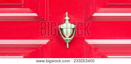 Old Antique Golden Brass Knocker On The Abstract Red Wooden Doors For Knocking Close Up
