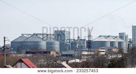 Elevator For Grain Storage. Grain Dryer. Agricultural Complex. Power Lines On The Elevators Backgrou