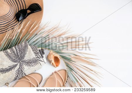 Summer Vacation Background. Top View Of Straw Hat, Green Palm Leaf ,ocean Shell, Beach Towel, Sungla